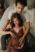 Pärchen bei einem Schwangerschaftsshooting im Münchener Fotostudio