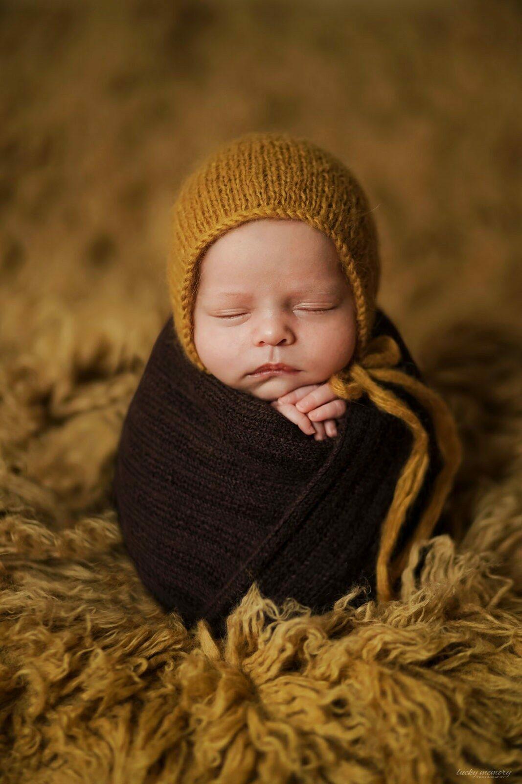 Baby Fotoshooting mit Neugeborenen Fotograf